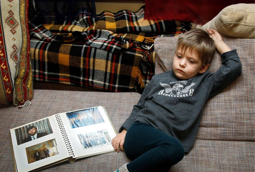Danil Sannikov, the 3-year-old son of a jailed Belarus presidential candidate and a journalist, is seen at home in Minsk, Belarus. (Associated Press)