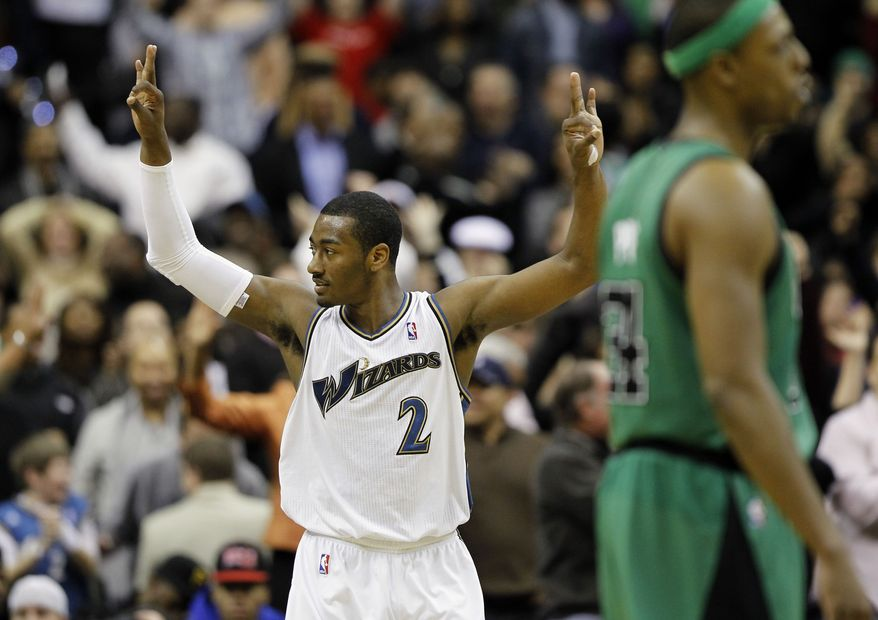 Washington Wizards guard John Hall (2) reacts as Boston Celtics forward Paul Pierce (34) walks to the bench late in the second half of an NBA basketball game in Washington on Saturday, Jan. 22, 2011. The Wizards won 85-83. (AP Photo/Alex Brandon)