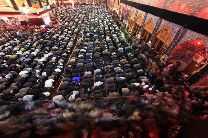 Shi'ite pilgrims pray at the Imam Abbas shrine in Karbala, 50 miles south of Baghdad, Iraq, Sunday, Jan. 23, 2011, as faithful flock to the holy city for Arbaeen, marking the end of the forty-day mourning period after the anniversary of the 7th century martyrdom of Imam Hussein, the Prophet Muhammad's grandson. (AP Photo/Ahmed al-Husseini)