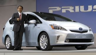 ** FILE ** Toyota Motor Corp. President Akio Toyoda introduces the Prius V midsize hybrid-electric vehicle at the North American International Auto Show in Detroit on Jan. 10, 2011. (AP Photo/Paul Sancya)
