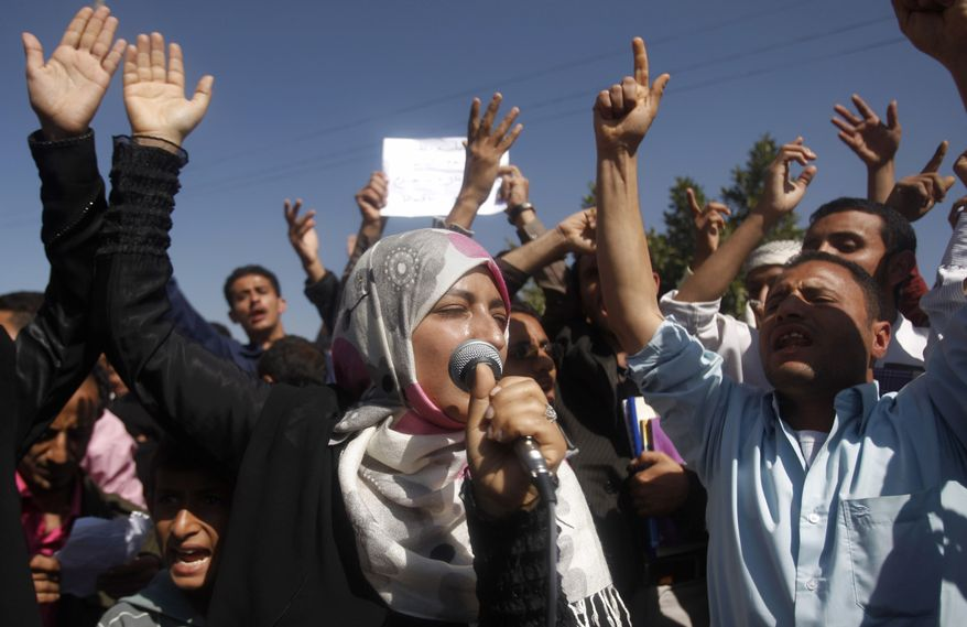 Yemeni students chant slogans calling on their president Ali Abdullah Saleh to leave the government and follow Tunisian ousted President Zine El Abidine Ben Ali into exile during a protest Saturday in Sanaa, Yemen. (Associated Press)