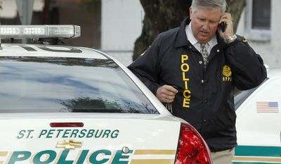 St. Petersburg, Fla., police Chief Chuck Harmon talks on a cell phone as he walks from the scene where a U.S. marshal and two St. Petersburg police officers were shot while trying to serve an arrest warrant on Monday, Jan. 24, 2011, in St. Petersburg. (AP Photo/Chris O'Meara)