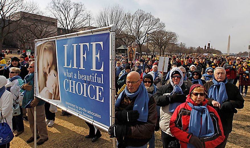 The national anthem is sung during an anti-abortion rally on the National Mall in Washington on Monday, Jan. 24, 2011. The anniversary of the Supreme Court's Roe v. Wade decision was Saturday. (AP Photo/Alex Brandon)