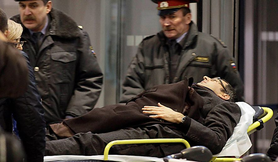 A man wounded in a blast is evacuated from Domodedovo Airport in Moscow, Monday, Jan. 24, 2011. An explosion ripped through the international arrivals hall at Moscow's busiest airport on Monday, killing dozens of people and wounding scores, officials said. Russian President Dmitry Medvedev called it a terror attack. (AP Photo/Ivan Sekretarev)