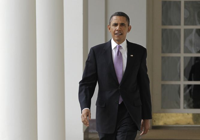 President Obama strides from the Oval Office along the Colonnade at the White House in Washington on Tuesday, Jan. 25, 2011. (AP Photo/J. Scott Applewhite)