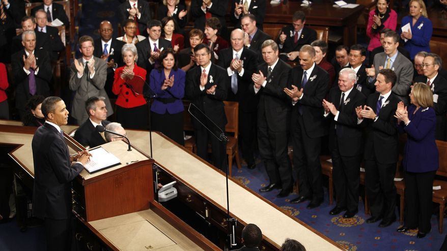 President Barack Obama is applauded on Capitol Hill in Washington, Tuesday, Jan. 25, 2011, prior to delivering his State of the Union address in Washington, Tuesday, Jan. 25, 2011. (AP Photo/Evan Vucci)