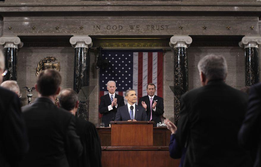 President Barack Obama delivers his State of the Union address on Capitol Hill in Washington, Tuesday, Jan. 25, 2011. Vice President Joe Biden and House Speaker John Boehner of Ohio applaud at rear. (AP Photo/Pablo Martinez Monsivias, Pool)