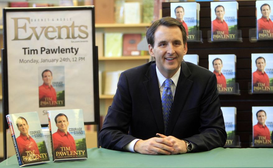 """Former Minnesota Gov. Tim Pawlenty, a Republican, gets ready to sign copies of his new book, """"Courage to Stand: An American Story,"""" on Monday, Jan. 24, 2011, in Manchester, N.H. (AP Photo/Jim Cole)"""