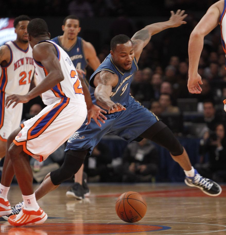 Washington Wizards forward Rashard Lewis (9) dives for a loose ball with New York Knicks guard Toney Douglas (23) unable to respond in the first half of their NBA basketball game at Madison Square Garden in New York, Monday, Jan. 24, 2011. (AP Photo/Kathy Willens)