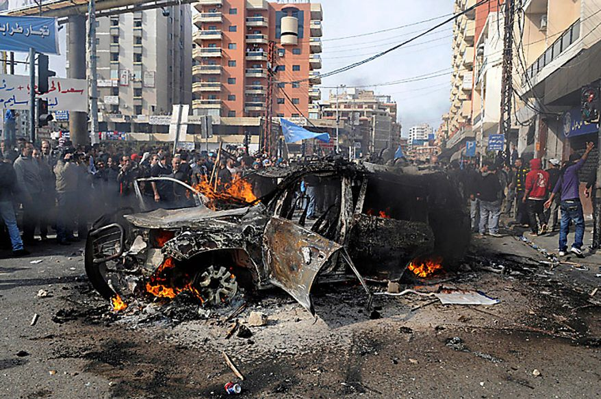 "A van belonging to Al Jazeera burns after protesters set it ablaze in the northern port city of Tripoli, Lebanon, Tuesday, Jan. 25, 2011. Thousands of Sunnis waved flags, burned tires and torched a van belonging to Al Jazeera on Tuesday during a ""day of rage"" to protest gains by the Shi'ite militant group Hezbollah, which now has enough support in parliament to control Lebanon's next government. (AP Photo/Ahmad Omar)"