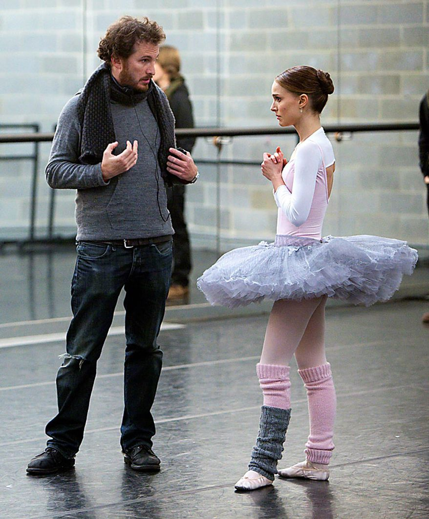 """Director Darren Aronofsky, left, and Natalie Portman are shown during the filming of """"Black Swan."""" Mr. Aronofsky was nominated for an Academy Award for best director for """"Black Swan."""" (AP Photo/Fox Searchlight, Niko Tavernise)"""