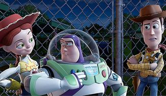 """** FILE ** Jessie, voiced by Joan Cusack, (from left) Buzz Lightyear, voiced by Tim Allen, and Woody, voiced by Tom Hanks, in a scene from """"Toy Story 3."""" (AP Photo/Disney Pixar)"""