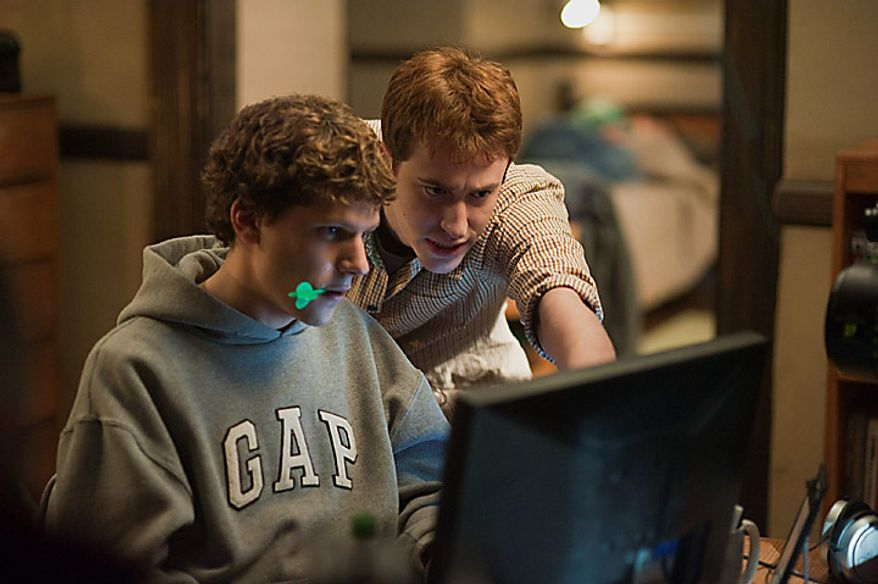 "Actors Jesse Eisenberg, left, and Joseph Mazzello in a scene from ""The Social Network."" The film was nominated for an Academy Award for best film, Tuesday, Jan. 25, 2011. The Oscars will be presented Feb. 27 at the Kodak Theatre in Hollywood.  (AP Photo/Columbia Pictures, Merrick Morton, File)"