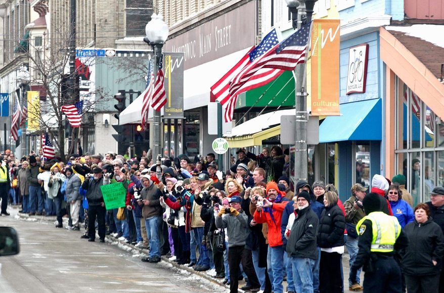 """People line the street Wednesday to greet President Obama during his visit to Manitowoc, Wis., part of the """"White House to Main Street Tour,"""" where he was to visit several renewable-energy factories and talk about jobs and the economy. (Associated Press)"""