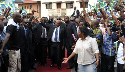 Andre Mba Obame has taken a self-administered oath of office and declared himself the new leader of Gabon. (Associated Press)