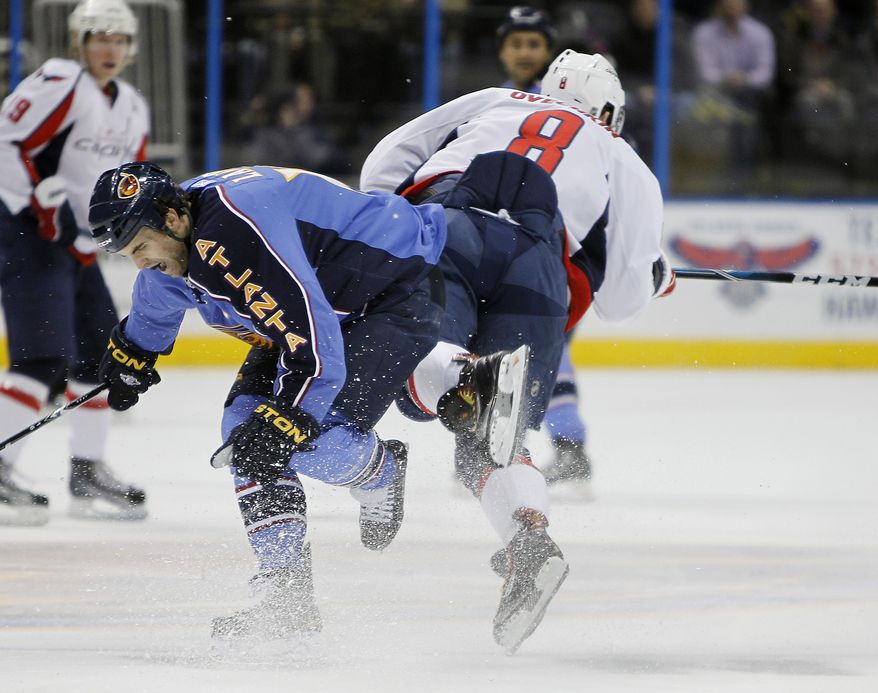 Atlanta Thrashers left wing Andrew Ladd (16) trips Washington Capitals left wing Alex Ovechkin (8) during the first period of an NHL hockey game Wednesday, Jan. 26, 2011 in Atlanta. (AP Photo/John Bazemore)