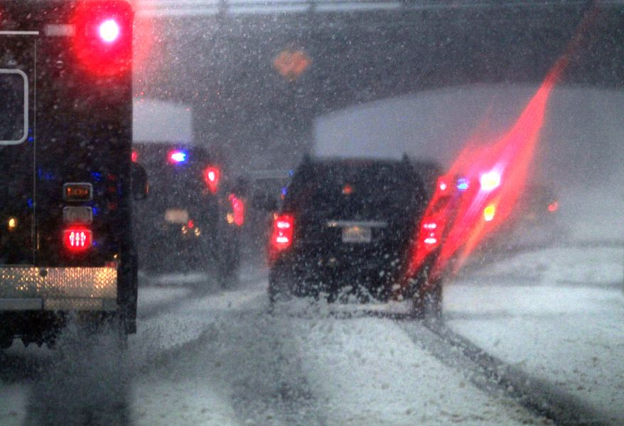 The motorcade carrying President Barack Obama makes its way through a snowstorm near Morningside, Md, Wednesday, Jan. 26, 2011, en route to the White House in Washington. (AP Photo/Carolyn Kaster)