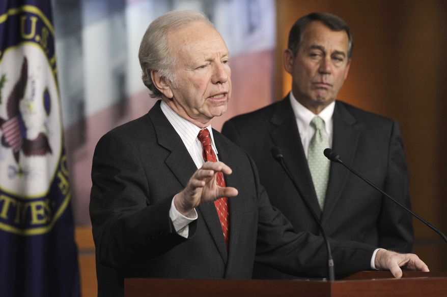 Sen. Joseph Lieberman, I-Conn., left, accompanied by House Speaker John Boehner of Ohio, gestures during a news conference on Capitol Hill in Washington on Wednesday, Jan. 26, 2011, to discuss the introduction of legislation on the D.C. Opportunity Scholarship Program . (AP Photo/Charles Dharapak)