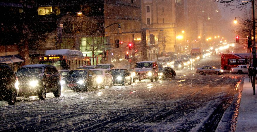 Vehicles clog the downtown streets of the District of Columbia on Wednesday. Icy roads created hazardous travel conditions for President Obama as he returned to the White House after a trip to Wisconsin. His driver spent an hour weaving through rush-hour traffic. (Associated Press)