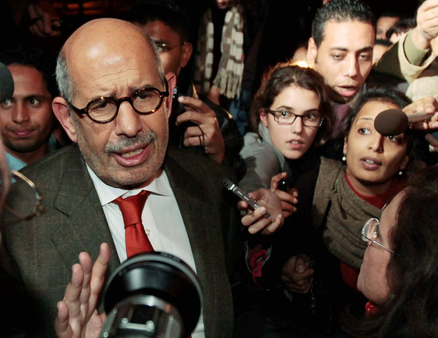 """Former Director General of the International Atomic Energy Agency and Nobel Peace Prize winner Mohammed ElBaradei arrives at Cairo's airport. He tells reporters """"the regime has not been listening."""" (Associated Press)"""