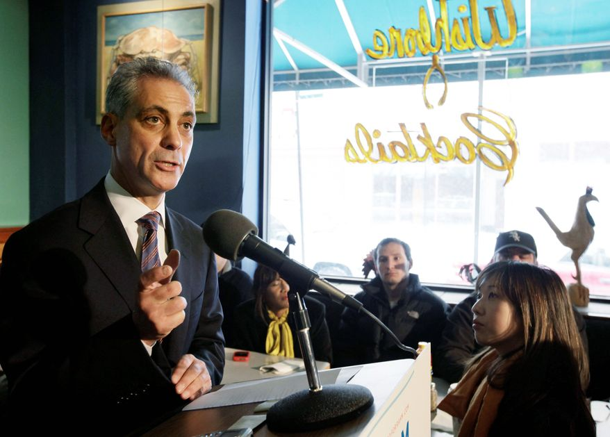 Rahm Emanuel discusses the mayoral race in Chicago after being endorsed by U.S. Rep. Mike Quigley in Chicago on Thursday. The state Supreme Court voted 7-0 to restore Mr. Emanuel's candidacy three days after an Illinois Appeals Court booted the Chicago native off the ballot. (Associated Press)