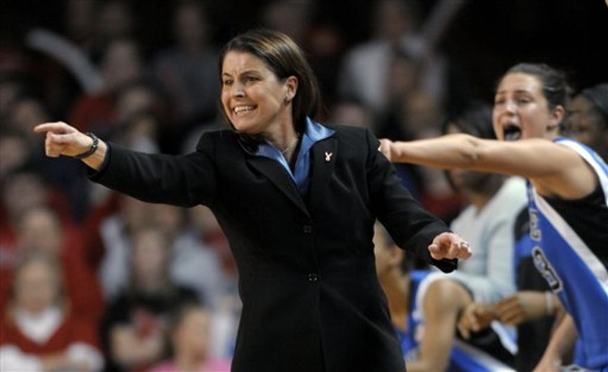 Duke coach Joanne McCallie yells to her team during the second half of an NCAA college basketball game against North Carolina State in Raleigh, N.C., Sunday, Jan. 23, 2011. At right is Duke's Haley Peters. Duke won 65-64. (AP Photo/Sara D. Davis)