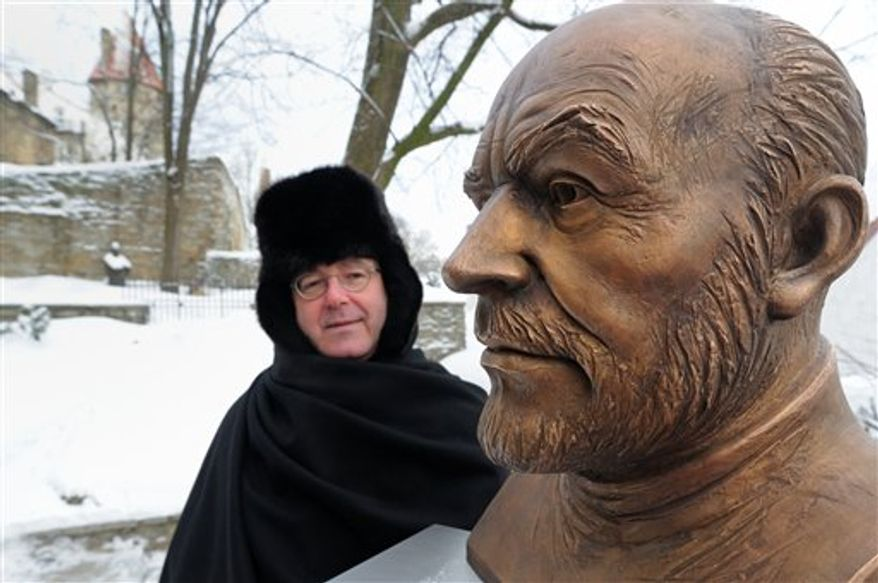 British Ambassador Peter Cater looks at  a bronze bust of Oscar-winning actor Sean Connery, a prominent Scottish nationalist, after unveiling it at the Scottish Club in Tallin, Estonia, Thursday, Jan. 27, 2011. The bust was created by Estonia's most famous sculptor Tiiu Kirsipuu, and is intended to mark the year Sir Sean turned 80. The club itself was first founded in 1993 as a whisky society, but became associated with prominent politicians and top business figures. Based in the heart of Tallinn's Unesco heritage site, its staff serve guests dressed in kilts, while the carpet is tartan(AP Photo/Timur Nisametdinov, NIPA)