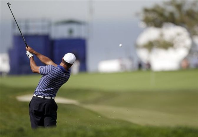 Phil Mickelson sports a smile after making birdie on the final hole but finishes second to Bubba Watson in the Farmers Insurance Open golf tournament in  San Diego, Sunday, Jan. 30, 2011. (AP Photo/Lenny Ignelzi)