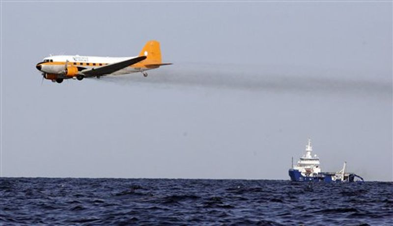 FILE -This June 3, 2010 file image from video provided by BP PLC shows oil dispersant being applied at the oil leak in the Gulf of Mexico. The white wand in the center is releasing the dispersant. The first peer-reviewed study looking at the effectiveness of chemical dispersants used deep undersea on the BP oil spill found mixed results. It appeared to keep some oil from bubbling up to the surface where it could do worse damage, but it didn't appear to biodegrade the oil quite as fast as promised. (AP Photo/BP PLC, File)