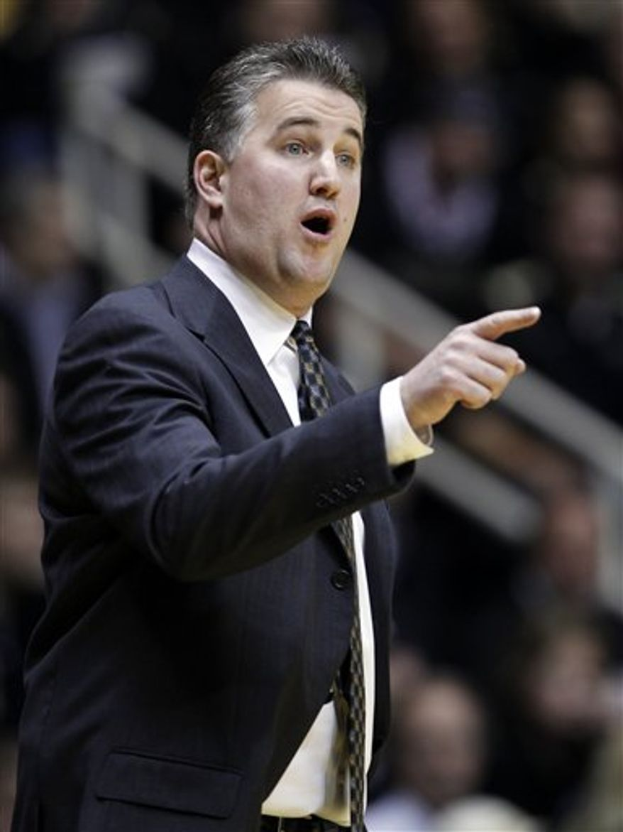 Purdue head coach Matt Painter calls a play against Michigan State in the first half of an NCAA college basketball game in West Lafayette, Ind., Saturday, Jan. 22, 2011. (AP Photo/Michael Conroy)
