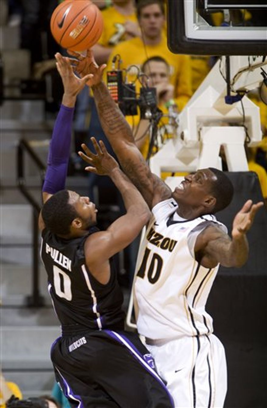 FILE - In this Jan. 17, 2011, file photo, Missouri's Ricardo Ratliffe, right, blocks the shot of Kansas State's Jacob Pullen, left, during the second half of an NCAA college basketball game in Columbia, Mo. Ratliffe has beefed up Missouri's inside game as one of the top junior college recruits. (AP Photo/L.G. Patterson, File)