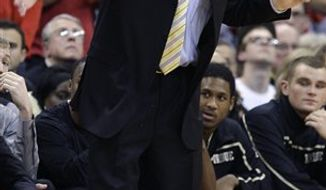Purdue coach Matt Painter gestures during the second half of Purdue's NCAA college basketball game against Ohio State on Tuesday, Jan. 25, 2011, in Columbus, Ohio. Ohio State beat Purdue 87-64. (AP Photo/Jay LaPrete)