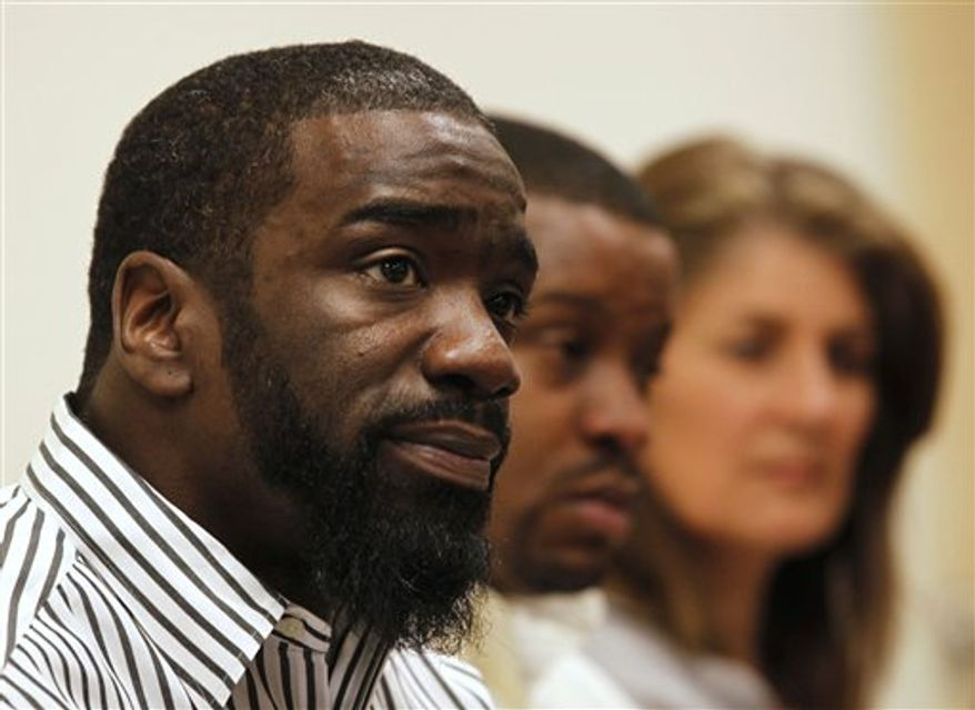 Baltimore Ravens player Ed Reed speaks at a news conference about the apparent recovery of his brother's body from the Mississippi River, at the St. Charles Parish Sheriff headquarters in Luling, La., Wednesday, Jan. 26, 2011. Authorities say a body recovered late Tuesday from the Mississippi River has been tentatively identified as Brian Reed.  Background is Reed's brother, Wendell Sanchez, and family friend Jeanne Hall. (AP Photo/Gerald Herbert)