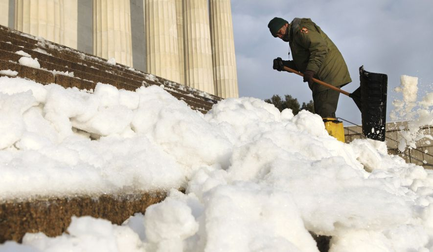 David Campbell, with the National Park Service, shovels snow off the steps of the Lincoln Memorial on the National Mall in Washington on Thursday, Jan. 27, 2011, after a large snow storm swept through the area the previous evening. (AP Photo/Jacquelyn Martin)
