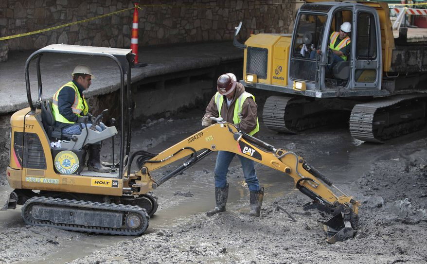 ** FILE ** Workers work along the San Antonio River Walk after the river was drained to clean out silt and muck and make repairs on Friday, Jan. 7, 2011, in San Antonio. (AP Photo/Eric Gay)