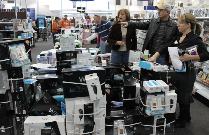 **FILE** Shoppers browse Nov. 26 at an electronics store in Albuquerque, N.M. The economy gained strength at the end of last year as Americans spent at the fastest pace in four years and U.S. companies sold more overseas. The growth is boosting hopes for a stronger 2011. The Commerce Department reported Friday that growth rose to an annual rate of 3.2 percent in the October-December quarter. (Associated Press)
