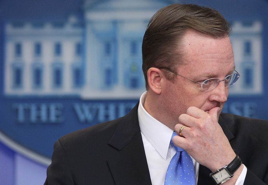 ** FILE ** Then-White House press secretary Robert Gibbs listens to a question on Egypt during his daily news briefing in the White House in Washington on Friday, Jan. 28, 2011. (AP Photo/Carolyn Kaster)
