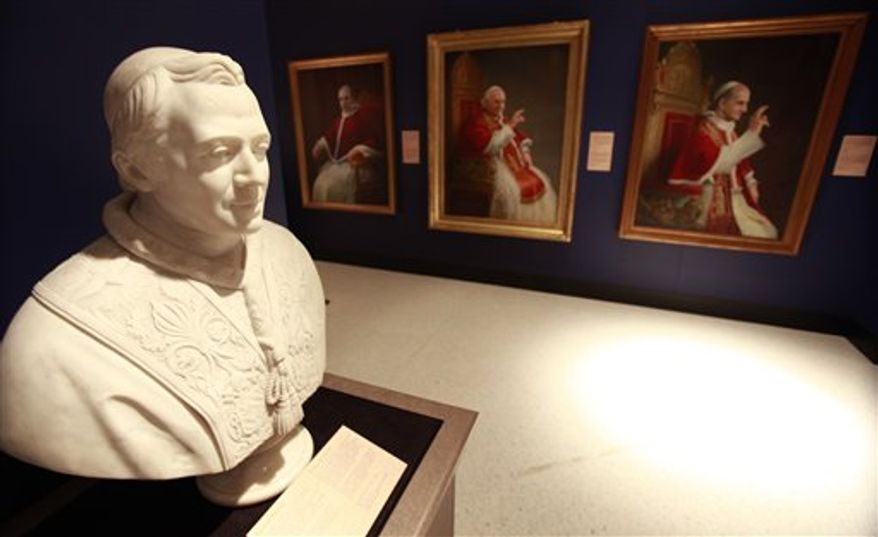 """In this Jan. 24, 2011 photo, busts and portraits of Popes are shown at the Museum of Art Fort Lauderdale in Fort Lauderdale, Fla. The objects from the Vatican are touring in the exhibit """"Vatican Splendors, A Journey Through Faith and Art,"""" which runs from Jan. 29 to April 24. (AP Photo/Wilfredo Lee)"""