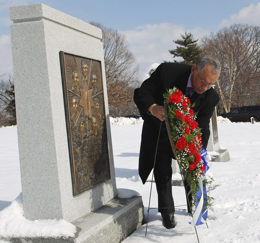 National Aeronautics and Space Administration Administrator (NASA) Charles Bolden lays a wreath at a Challenger memorial, at Arlington National Cemetery, in Arlington, Va., on Thursday, Jan. 27, 2011, in commemoration of NASA's National Day of Remembrance. (AP Photo/Manuel Balce Ceneta)