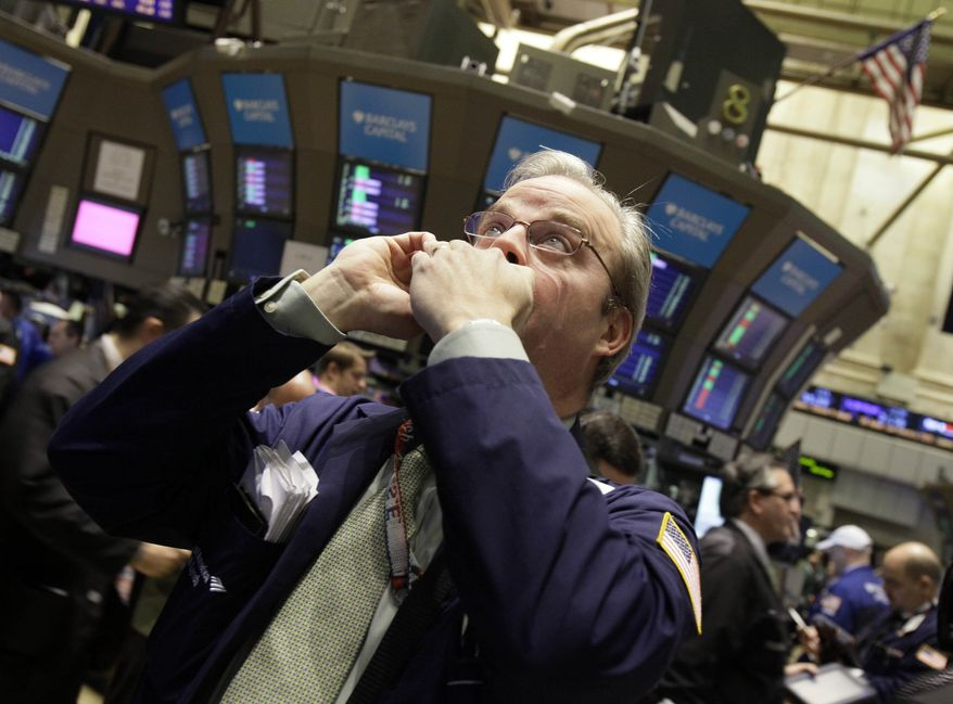 Trader David O'Day talks on his mobile phone as he works on the floor of the New York Stock Exchange Friday, Jan. 28, 2011. (AP Photo/Richard Drew)