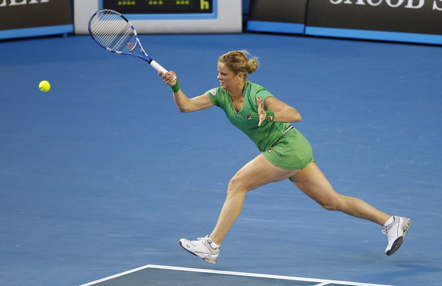 Belgium's Kim Clijsters makes a forehand return to China's Li Na during the women's singles final at the Australian Open tennis championships in Melbourne, Australia, on Saturday, Jan. 29, 2011. (AP Photo/Vincent Thian)