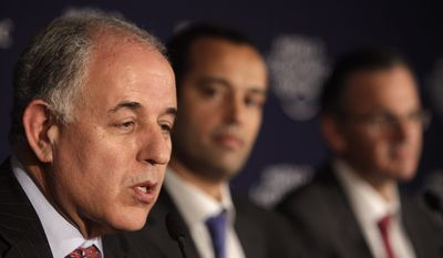 From left, Tunisia's Central Bank Governor Mustapha Kamel Nabli, Tunisia's Minister for Infrastructure and Transport Yassine Brahim and Minister of Communication Technology Sami Zaoui participate in a media conference regarding recent events in Tunisia at the World Economic Forum in Davos, Switzerland on Saturday, Jan. 29, 2011. (AP Photo/Virginia Mayo)