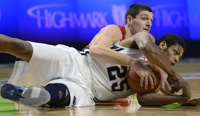 Penn State's Jeff Brooks (25) and Wisconsin's Keaton Nankivil go after a loose ball in the first half of an NCAA college basketball game in State College, Pa., Saturday Jan. 29, 2011. (AP Photo/John Beale)