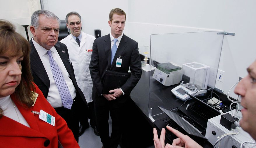 Transportation Secretary Ray LaHood (center) examines the new Driver Alcohol Detection System for Safety in Waltham, Mass., on Friday. One of the prototype components is a small black box attached to wires (far right). Shane Karr (right), vice president for Federal Government Affairs at the Alliance of Automotive Manufacturers, looks on. Laura Dean Mooney (left), national president of Mothers Against Drunk Driving, watches. (Associated Press)