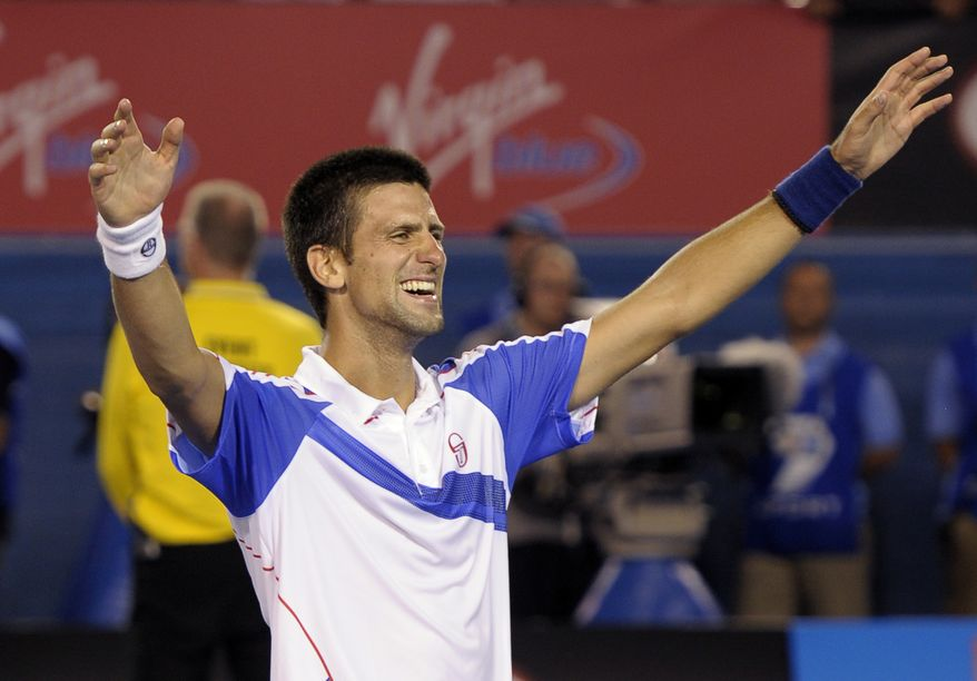 Novak Djokovic of Serbia celebrates after beating Andy Murray of Britain in the men's singles final at the Australian Open tennis championships in Melbourne, Australia, on Sunday, Jan. 30, 2011. (AP Photo/Rob Griffith)