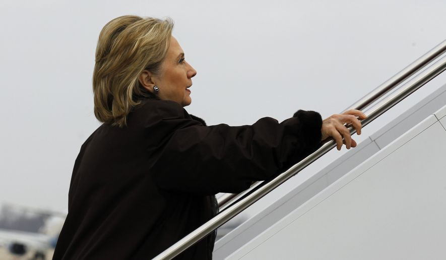 Secretary of State Hillary Rodham Clinton boards a plane at Andrews Air Force Base outside Washington for a trip to Haiti on Sunday, Jan. 30, 2011. (AP Photo/Alex Brandon, Pool)