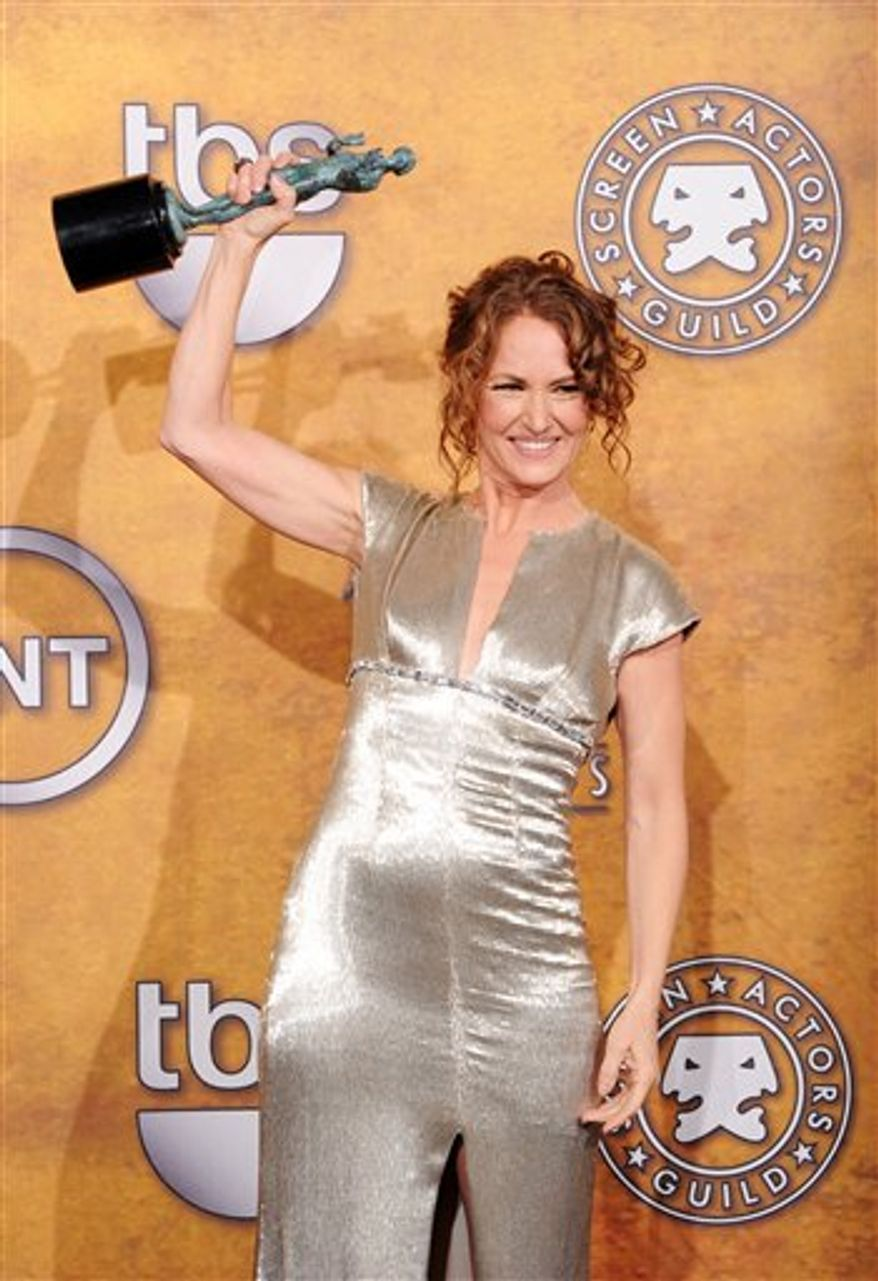 """Melissa Leo holds the award for best female actor in a supoorting role for her work on """"The Fighter"""" at the 17th Annual Screen Actors Guild Awards on Sunday, Jan. 30, 2011 in Los Angeles. (AP Photo/Vince Bucci)"""