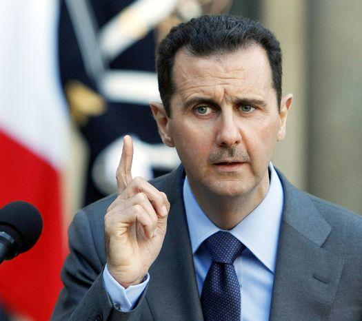 **FILE** Syrian President Bashar Assad (Associated Press)