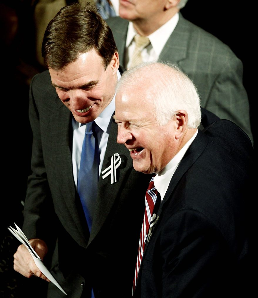 "Sen. Mark Warner (left), Virginia Democrat, and Sen. Saxby Chambliss, Georgia Republican, are working on a bill that incorporates controversial recommendations from the president's fiscal commission. Mr. Warner said Monday that Congress must cut federal spending, ""including entitlement programs,"" enact comprehensive tax reform and ""grow the economy by adopting an innovation and growth agenda."" He added, ""It will require all three of those elements because no single one of them alone will get the job done."" (Associated Press)"