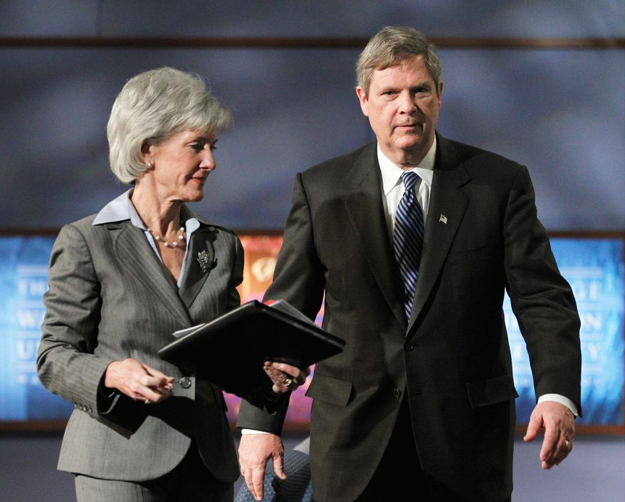 Health and Human Services Secretary Kathleen Sebelius and Agriculture Secretary Tom Vilsack announce new dietary guidelines to help Americans make healthier food choices and confront the obesity epidemic at George Washington University in Washington, D.C., on Monday. (Associated Press)